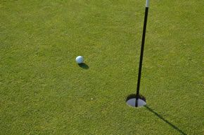 With a pitching wedge, Devin got this close to a hole in one and a Mercedes Benz last year!