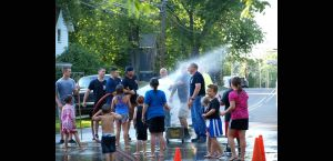 Fire Dept. washing of the streets with the kids of Bath